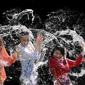 Girls in splash by Hendrik Cuaca - People Street & Candids