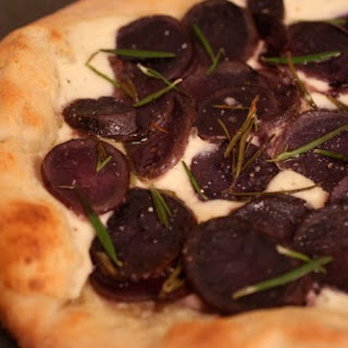 Roasted Purple Potato Pizza with Ricotta and Rosemary.