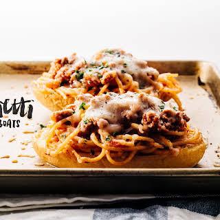 Cheesy Spaghetti Bolognese on Crispy Garlic Bread Boats.