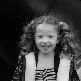 Christy in the slide by Scott Morgan - Babies & Children Children Candids ( girl child, little girl, static, b&w, girl, black and white, happy, slide, hair, tunnel,  )