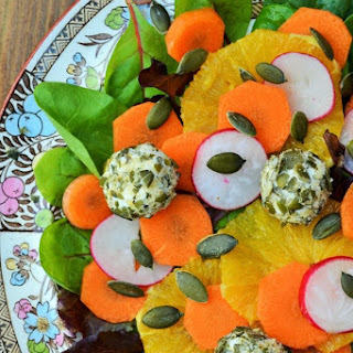 Orange, Carrot and Goats Cheese Salad with Pumpkin Seeds.