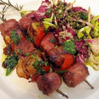 Rosemary skewers with Tuscan sausage, bread and pancetta.