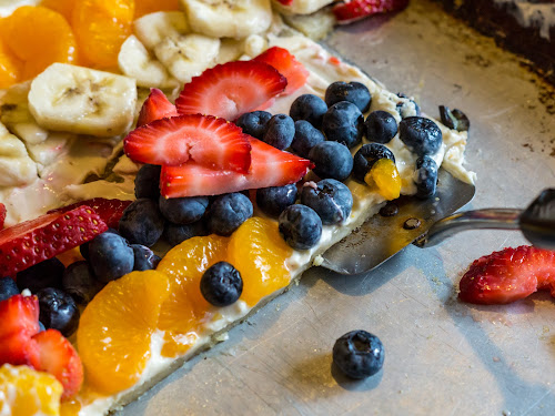 Slice of Fruit Pizza by Nicole Mitchell - Food & Drink Cooking & Baking ( mandarin oranges, banana, cookie sheet, spatula, strawberries, blueberries, sugar cookie, , Food & Beverage, meal, Eat & Drink )