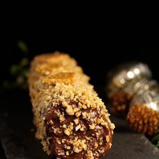 Rolled Cake with Caramel Nuts and Chocolate Nougat Powder.