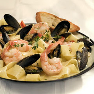 Shrimp & Mussels In Wine Sauce With Garlic Crostini.