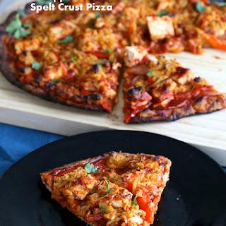 Sriracha BBQ tofu Pizza with Pepper Jack Cheese on thin Spelt Crust.