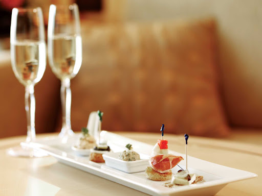 Cunard-champagne-canapes - Enjoy fine champagne and canapes while cruising on one of Cunard's luxury cruise ships.
