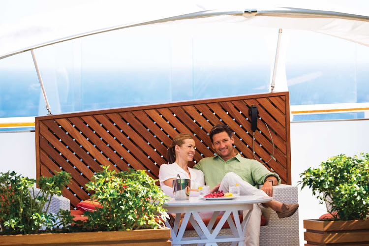 Sit on the Celebrity Reflection's deck and people watch or take in a game of lawn bowls with a fruit platter and a refreshment.