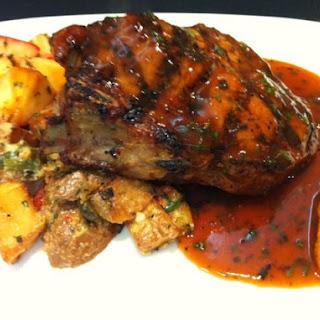Grilled Pork Chop with Rosemary Teriyaki Butter Glaze, Fingerling Potatoes.