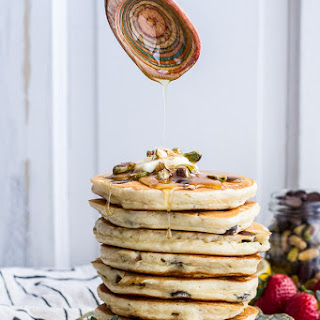 Chocolate Chip Lemon Baklava Pancakes with Salted Vanilla Honey Syrup.