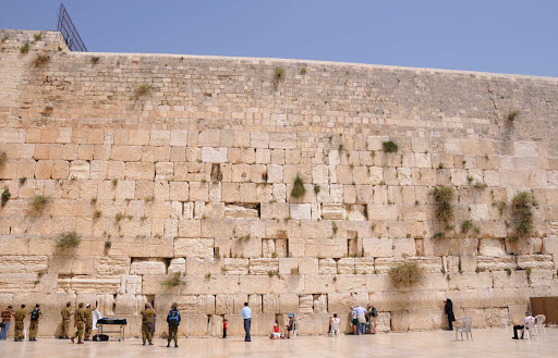 Western-Wall - Israeli soldiers, Israelis and visitors mingle and pray at the Western Wall in Old Jerusalem.