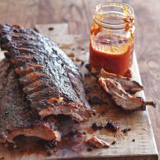 Grilled Baby Back Ribs with Citrus Barbecue Sauce.