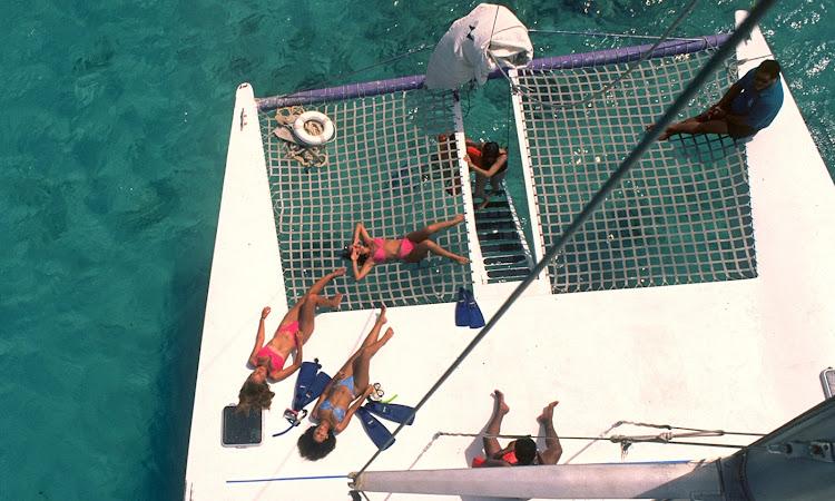 Cruising on a catamaran in the waters of Aruba.