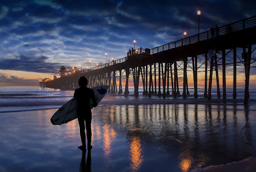 Admiration by Alan Crosthwaite - Landscapes Beaches ( beach backgrounds, oceanside, beach sunsets, southern california, oceanside pier, pier backgrounds, tourism, travel, people, coastal, destination, silhouetted, admiration, san diego, piers, surfer, surfboard, travel backgrounds, sunset, pier sunsets, pier, silhouettes )