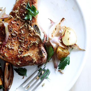 Fennel-Crusted Pork Chops with Potatoes and Shallots.