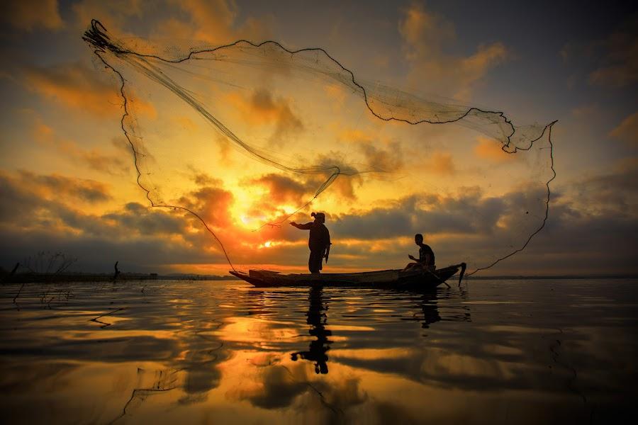 Fisherman by Anek Suwannaphoom - People Street & Candids ( laos, reflection, fish, tropical, thailand, travel, net, kayak, burma, asian, bangkok, mirror, balance, tranquil, farmer, nature, poverty, tradition, province, asia, man, water, inle, peaceful, weed, poor, entrapment, job, lake, tourism, traditional, boat, myanmar, environment, blue, sunset, food, ripple, fishing, sunrise, fisherman, reflect, paddle, river )