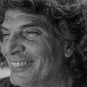 Portrait by Rich Eginton - People Portraits of Men ( b^w, long hair, curls, smile, weathered face )