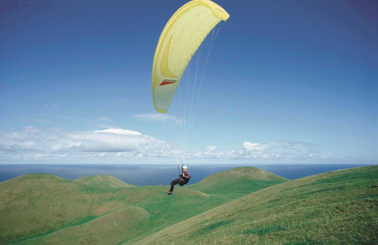 YOLO, right? Take the adventure of a lifetime by paragliding over Iles-de-la-Madeleine (Magdalen Island) in in the Gulf of Saint Lawrence, Canada.