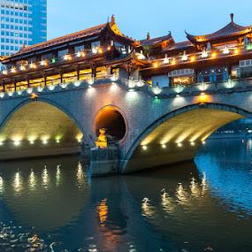 Veranda Restaurant in Chengdu, China by Photoxor AU - Buildings & Architecture Bridges & Suspended Structures ( lights, reflection, veranda restaurant, chengdu, bridge, river, china, city, night, , Urban, City, Lifestyle, relax, tranquil, relaxing, tranquility )