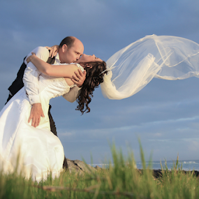 Kiss of the Sun by Lood Goosen (LWG Photo) - Wedding Bride & Groom ( kiss, wedding photography, wedding, veil in the wind, beach )