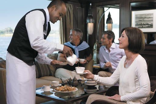Uniworld-River-Tosca-lounge - Enjoy your favorite beverage and experience attentive service during your voyage through Egypt aboard Uniworld's River Tosca.