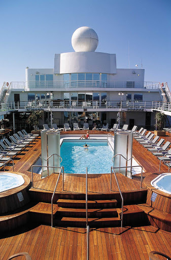 Soak up the sun while reveling in the picturesque views from the pool deck of Seven Seas Navigator.