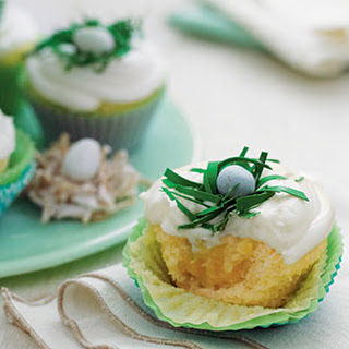 Pineapple-Coconut Cupcakes with Buttermilk-Cream Cheese Frosting.