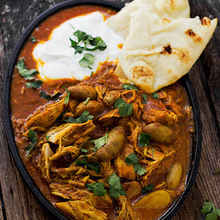 Indian Spiced Stew with Chicken and Potatoes in a Tomato Cream Sauce.