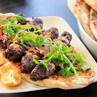 Kofte Kebabs with Spicy Harissa Yogurt Sauce and Grilled Flatbread (Minced Lamb Kebabs).