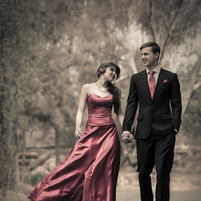 A walk in the park by Lood Goosen (LWG Photo) - People Couples ( love, walking, wonam, red, couple, people, man, holding hands,  )