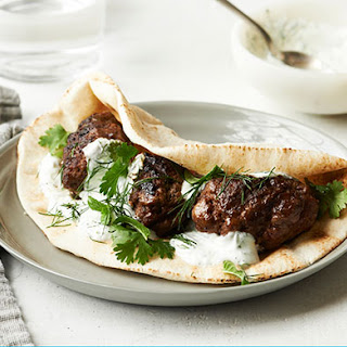 Spiced Middle Eastern Lamb Patties with Pita and Yogurt.