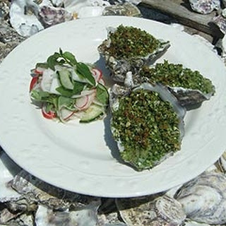 Oysters Rockefeller with radish and turnip pickle