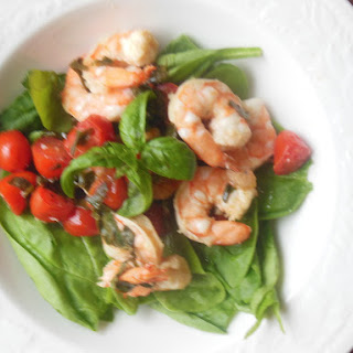 Basil Shrimp and Tomatoes Over Spinach.