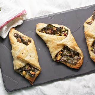 Swiss Chard Turnovers with Parmesan and Pistachios.