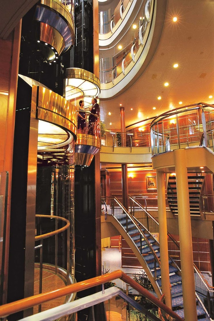The abundance of space throughout the ship, including the Atrium here, will impress you during your stay on Seven Seas Navigator.