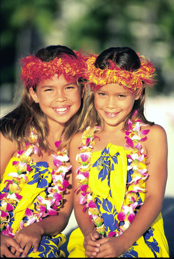 two-Hawaiian-girls - Two young girls with Haku lei on the  beach in Hawaii.