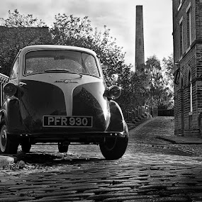 1957 BMW Isetta by Chris Duffy - Transportation Automobiles ( cobbles, car, mill, vintage, black and white, saltaire, 1957, bmw, bubble car, world heritage site,  )