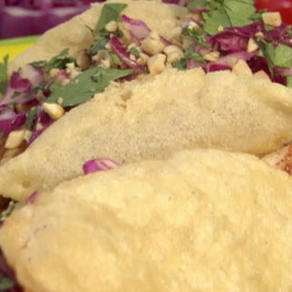 Yucatan chicken puffy tacos with peanut-red chilli BBQ sauce and red cabbage coleslaw