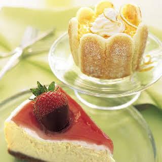 Mascarpone Cheesecake with Rhubarb Glaze and Chocolate-Covered Strawberries.