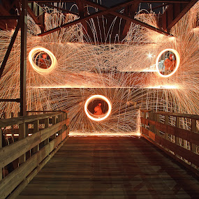 Hot Threesome by Jamie Rabold - Abstract Light Painting ( fire circles, light painting, steel wool, spinning fire, north shore, duluth mn, sparks, night shot, spinning wool, fire )