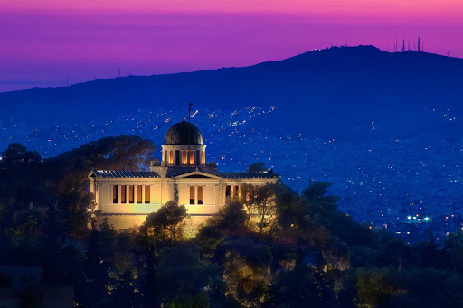 national-observatory-athens-greece - The National Observatory and surrounding hillsides at twilight in Athens, Greece.