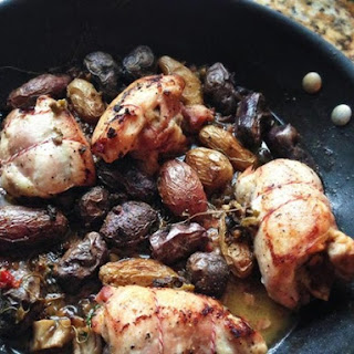 Wild Mushroom-Stuffed Chicken Thighs With Fingerling Potatoes and Green Olives.