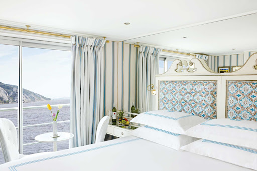 Uniworld-River-Countess-suite - Guests will be able to take in the breathtaking scenery of Northern Italy from the comfort of their own suite while traveling aboard the River Countess. The Uniworld ship carries 134 passengers, offering four suites and 67 outside cabins.