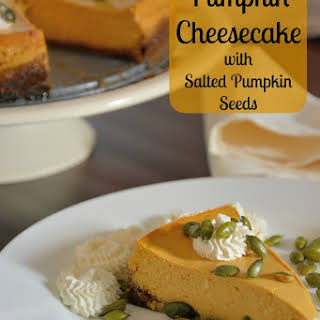Pumpkin Cheesecake with Spiced Whipped Cream and Salty Pumpkin Seeds.