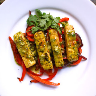 Citrus-Marinated Tofu with Onions and Peppers.