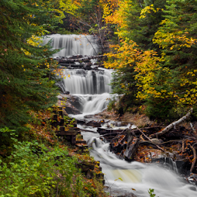 Sable Falls at Pictured Rocks by Kenneth Keifer - Landscapes Waterscapes ( stream, colorful, waterfall, flow, blur, leaves, landscape, forested, grand marais, nature, autumn, sable falls, secluded, foliage, creek, splashes, long exposure, wet, motion, rocks, sable, water, flowing, national lakeshore, beautiful, wooded, forest, scenic, great lakes, woods, maple, blurred, michigan, upper peninsula, national park, wilderness, splashing, color, cascade, fall, trees, cataract, cascading, october, hemlock, ledges, pictured rocks, whitewater )