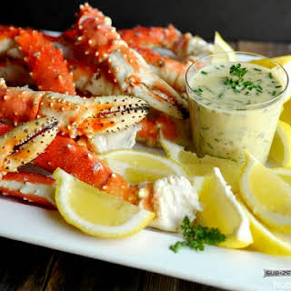 Steamed Alaskan King Crab Legs with Beurre Blanc for Dipping.