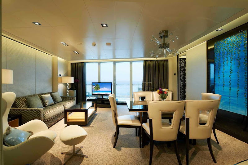 A contemporary living and dining area with room to spread out is one of the things guests love about the Norwegian Breakaway's Deluxe Owner's Suite.