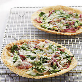 Whole Wheat Pita Pizzas with Spinach, Fontina, and Onions.