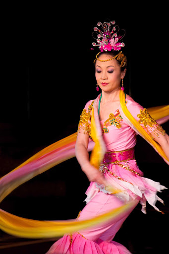 Be dazzled by the lovely ribbon dancers in the Hong Kong Folkloric Show aboard an Azamara cruise.